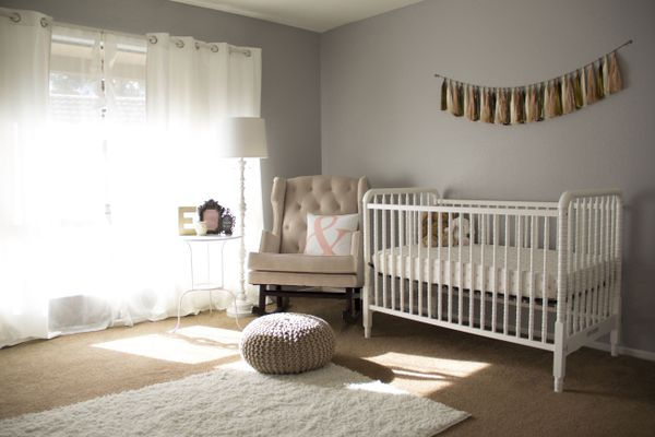 Crib by armchair at home