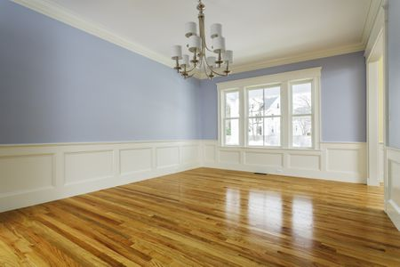 Empty Dining Room With Shiny Hardwood Floors