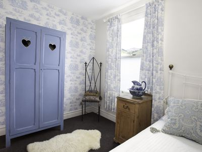 Blue toile in a cottage bedroom.