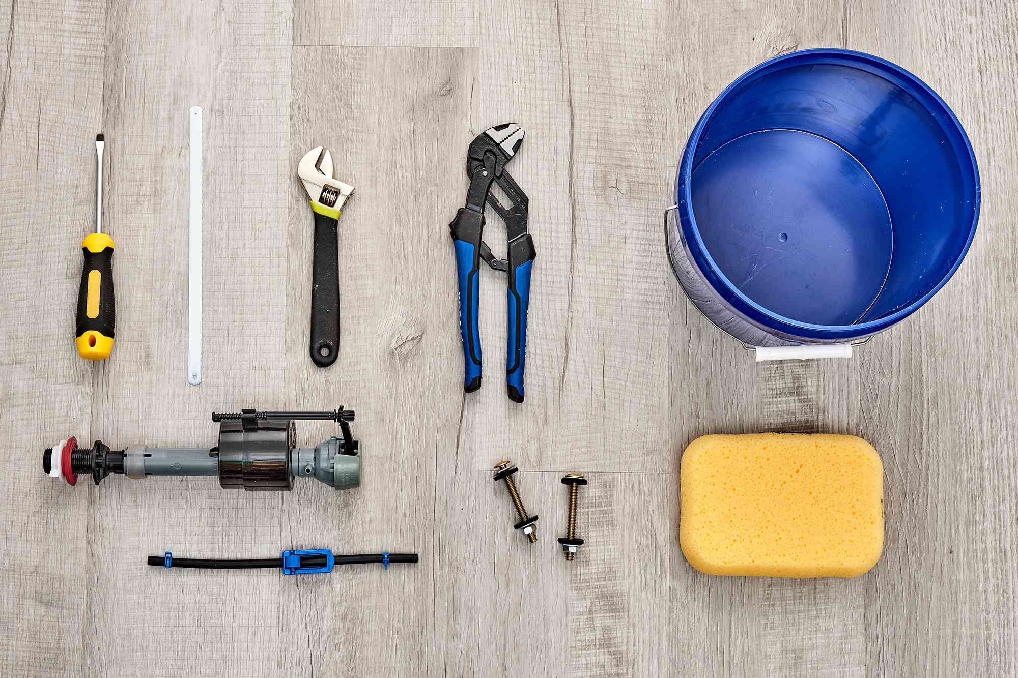 Materials and tools to replace a toilet flush valve