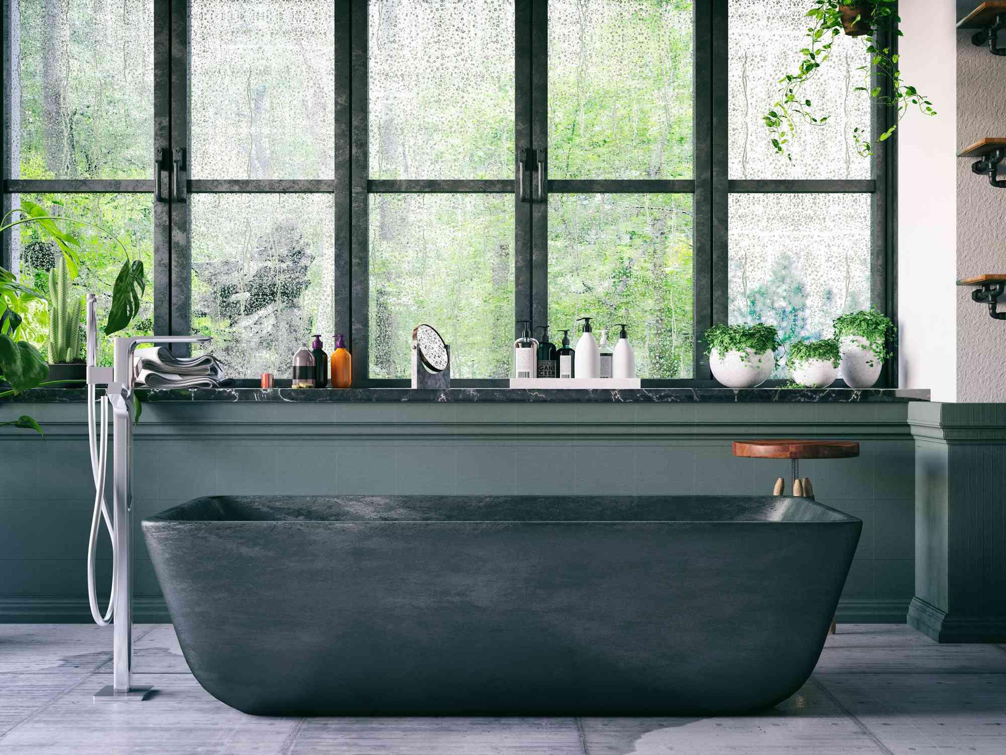 Industrial bathroom with black tub