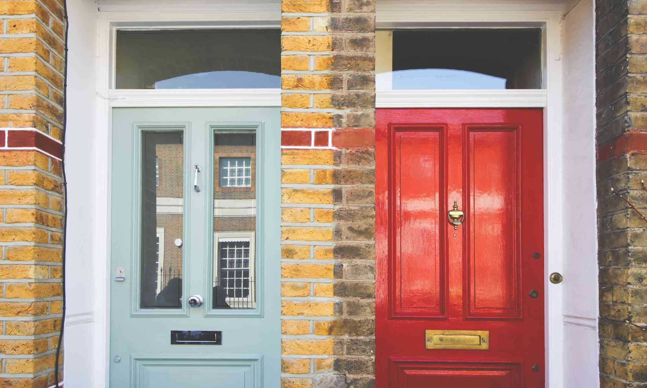 green and red front doors next to each other