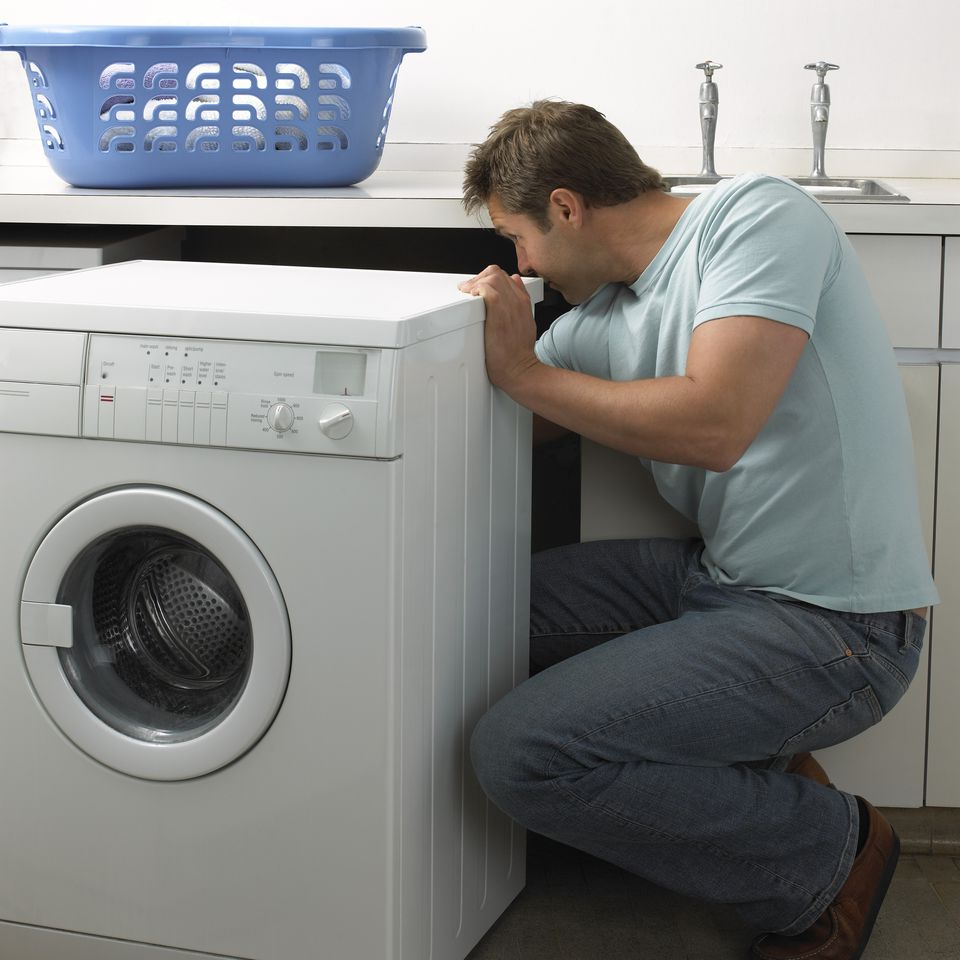 Man working on a washing machine