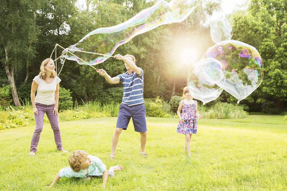 A picture of a family playing with bubbles