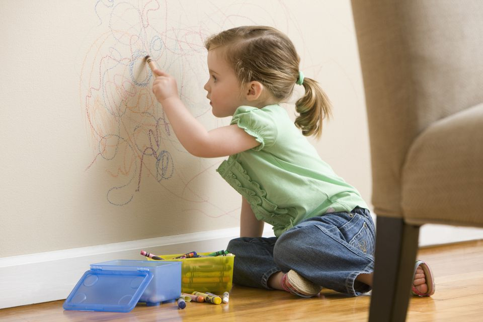 Girl drawing on wall