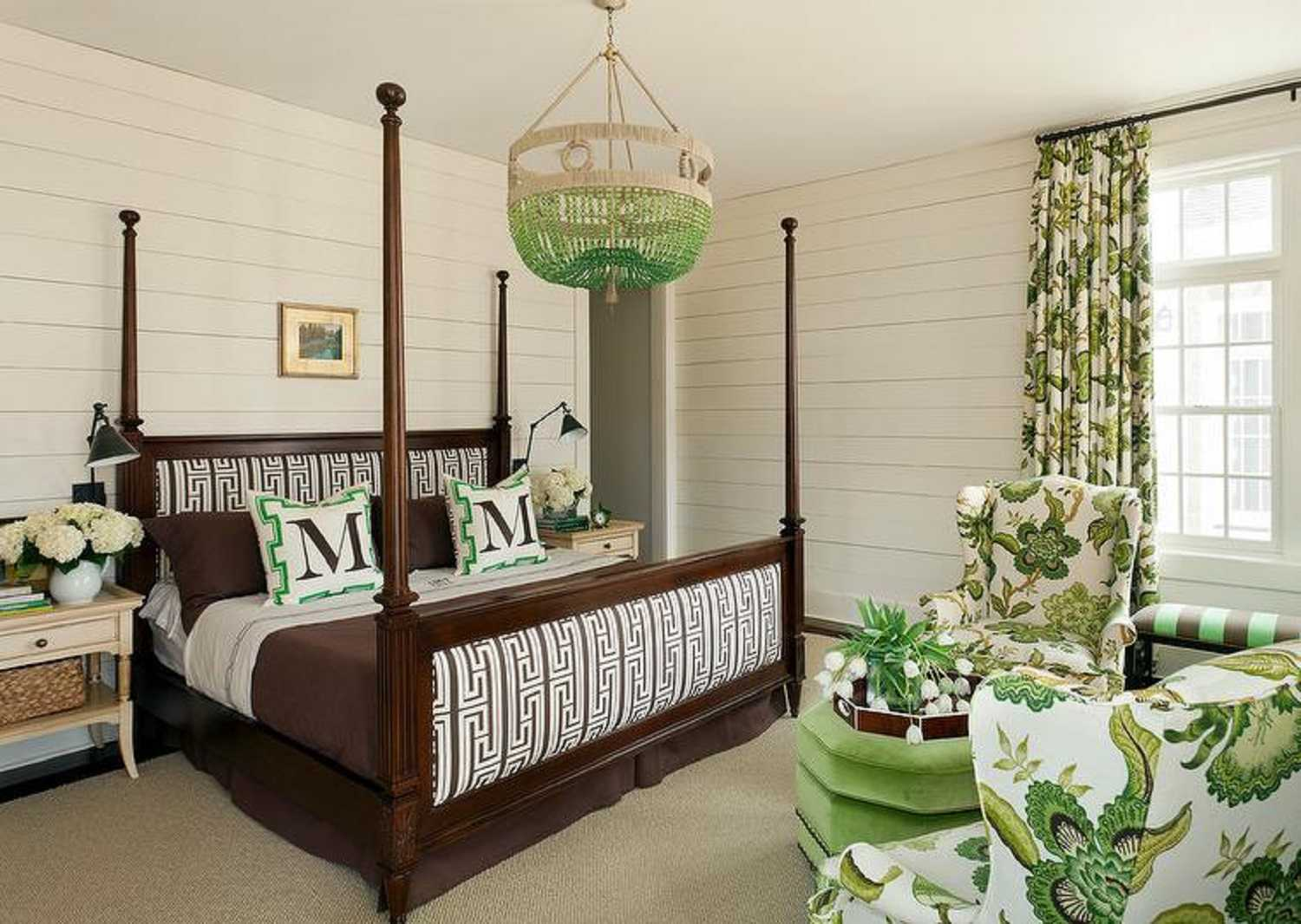 Green and brown bedroom with chandelier