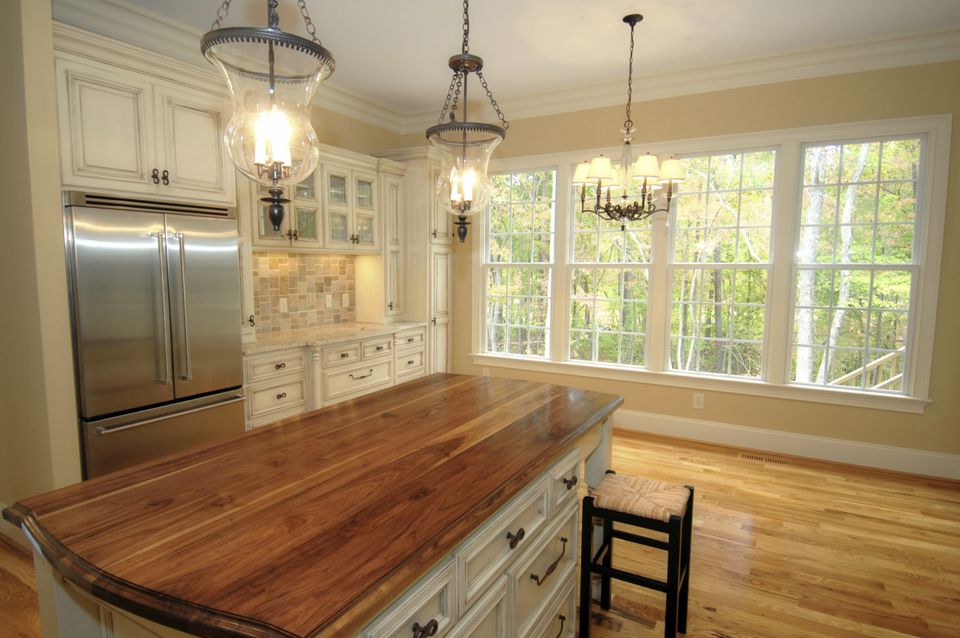 Traditional Kitchen Using Large Chandelier Lights Over Island