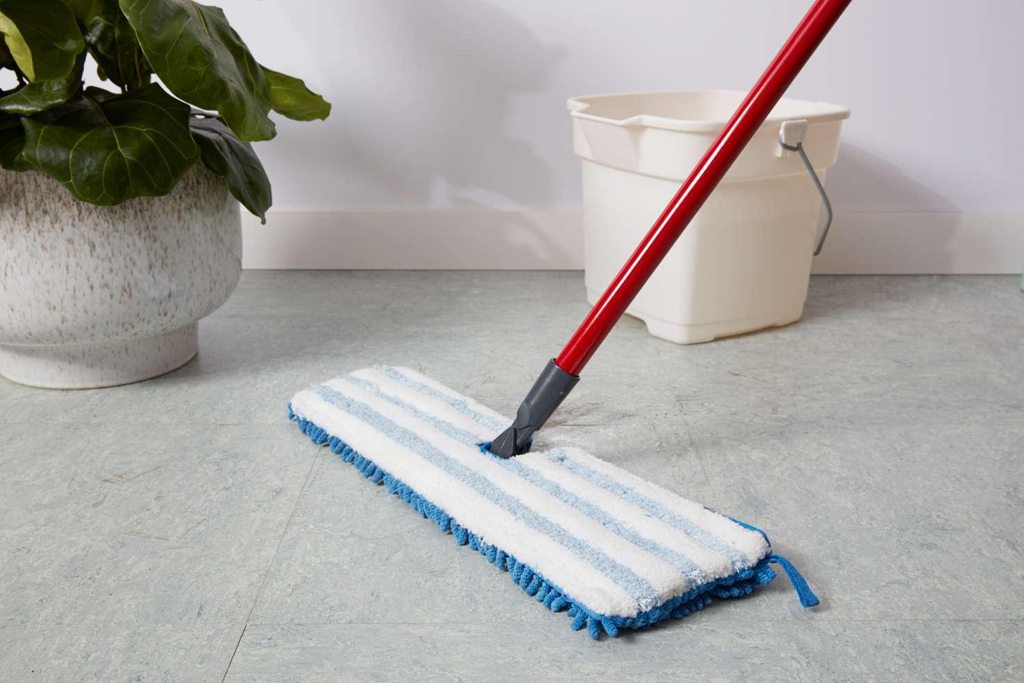 Cleaning linoleum floor with microfiber mop