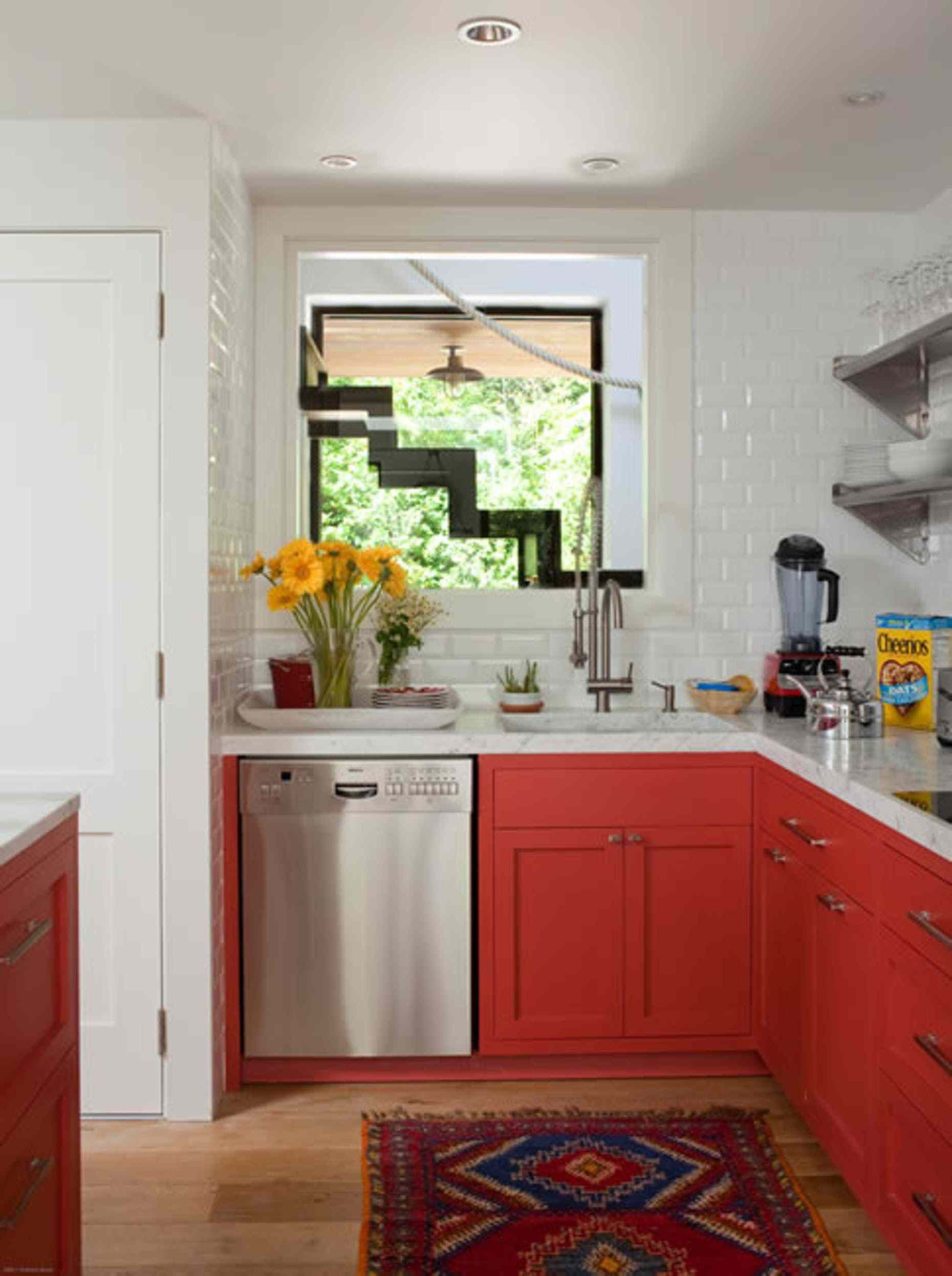 kitchen with red lower cabinets