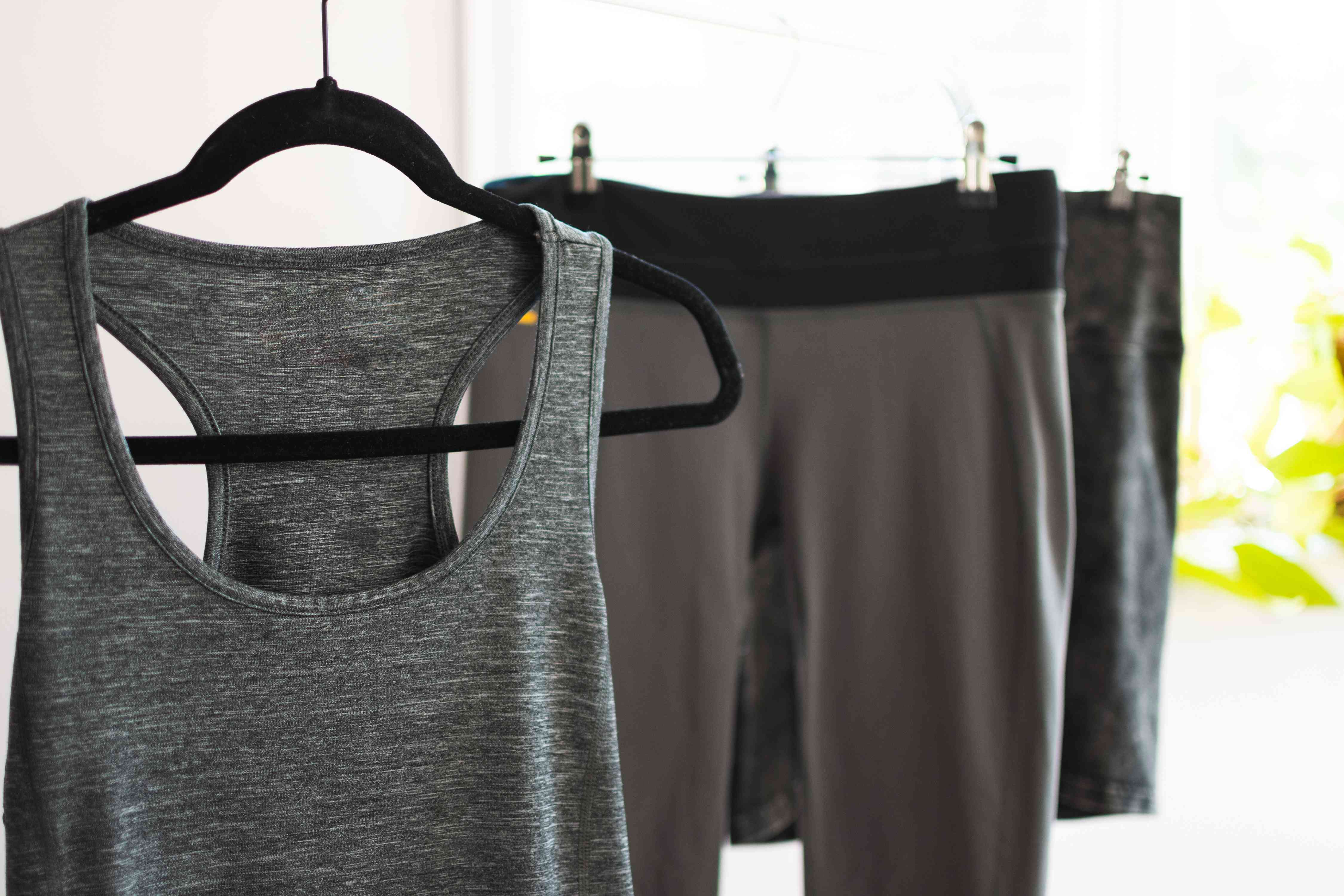 Olefin gray workout top and pants on hangers