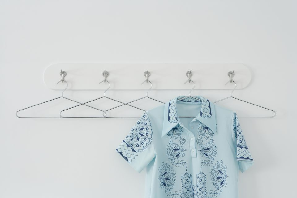 shirt hanging on wire hanger