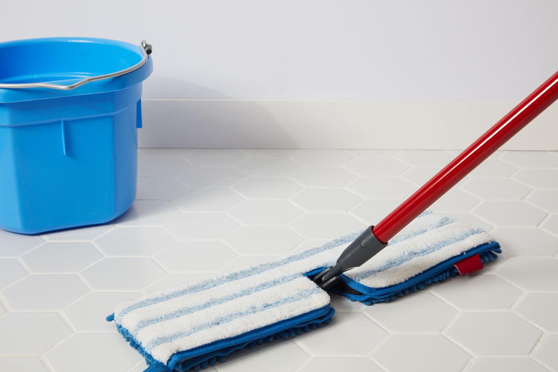 Deep cleaning porcelain floor with microfiber mop