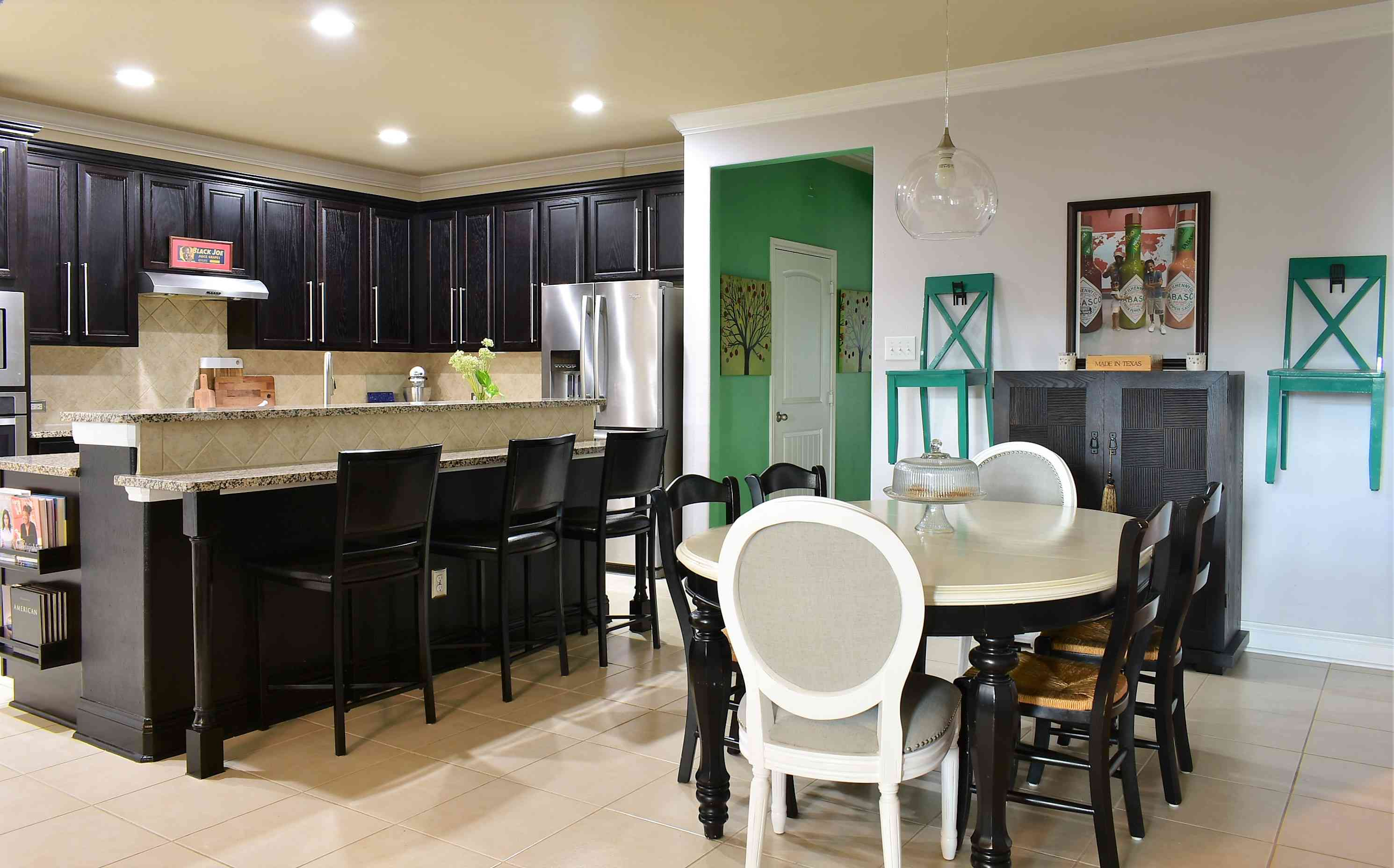 Green accent chairs in kitchen
