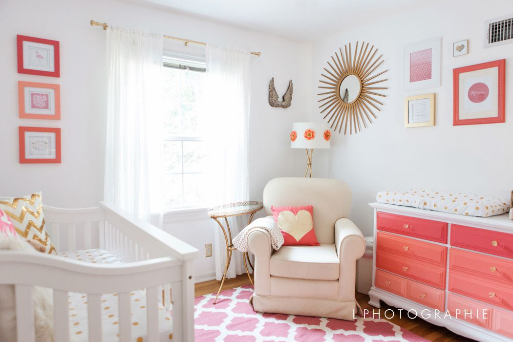 White nursery with bold coral accents