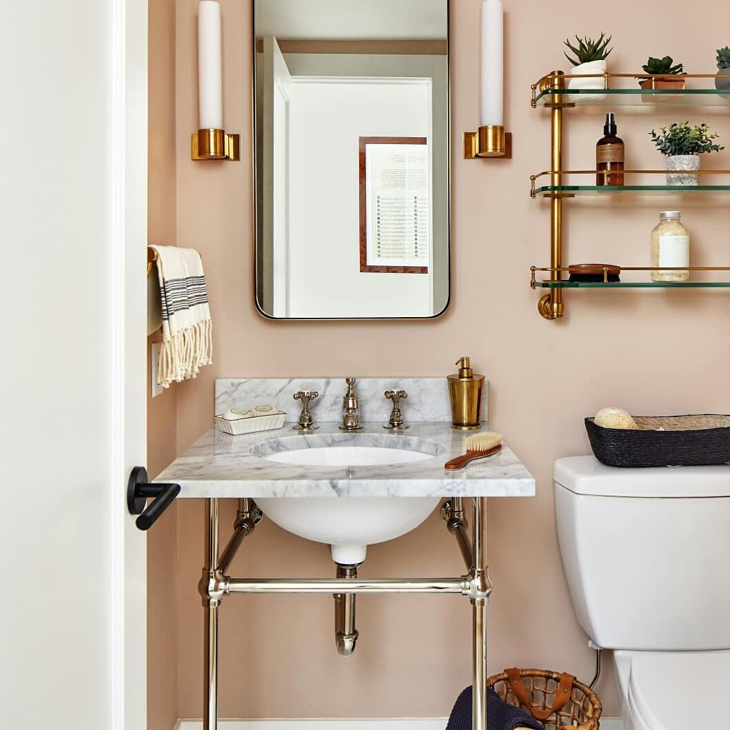 Powder room with light peach paint