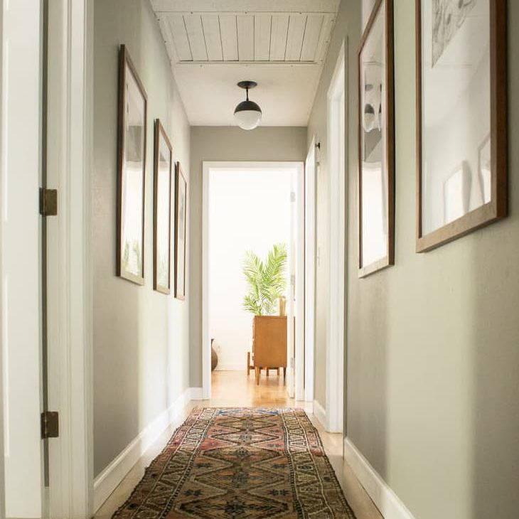 Long, Narrow Corridor With Area Rug