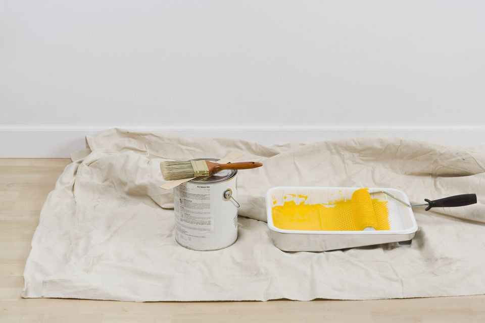 Painting supplies on a drop cloth