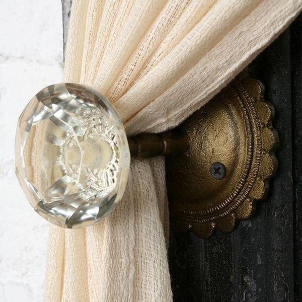 Vintage doorknobs repurposed as curtain tiebacks