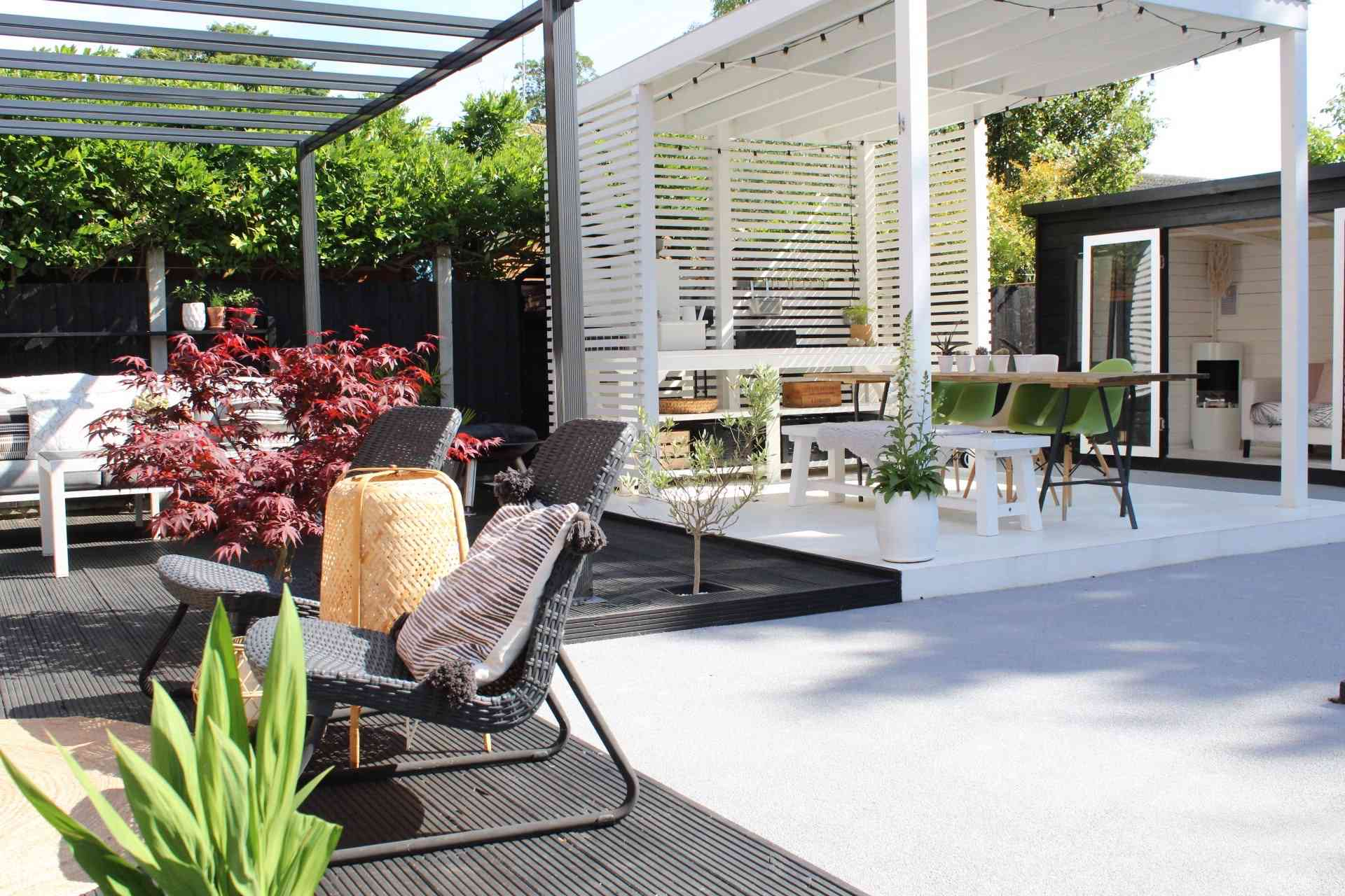 outdoor space with a white covered patio and a black-and-white theme