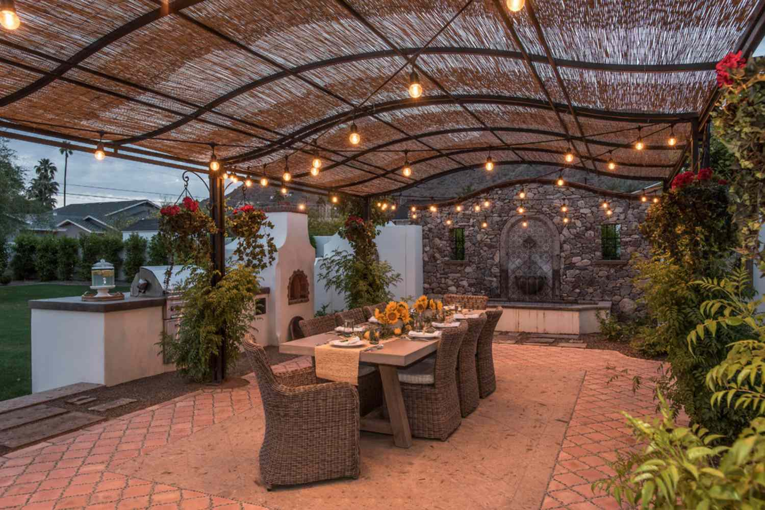 covered patio with thistle roof and adobe style dining room