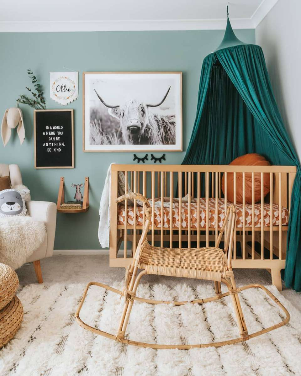 Boho nursery win muted teal walls and natural accents