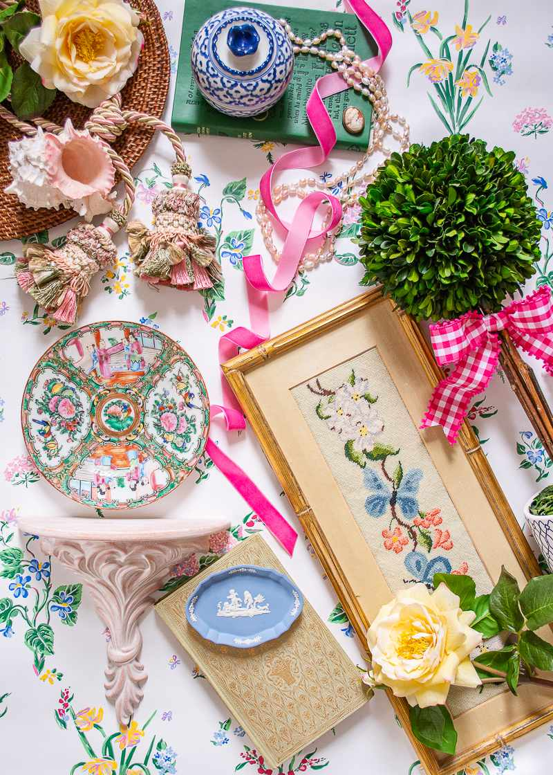 Floral artwork and ceramics on flower tablecloth