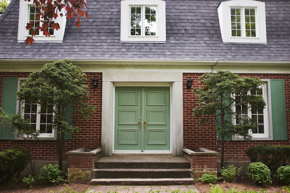 Cropped full frame view of house exterior with green door