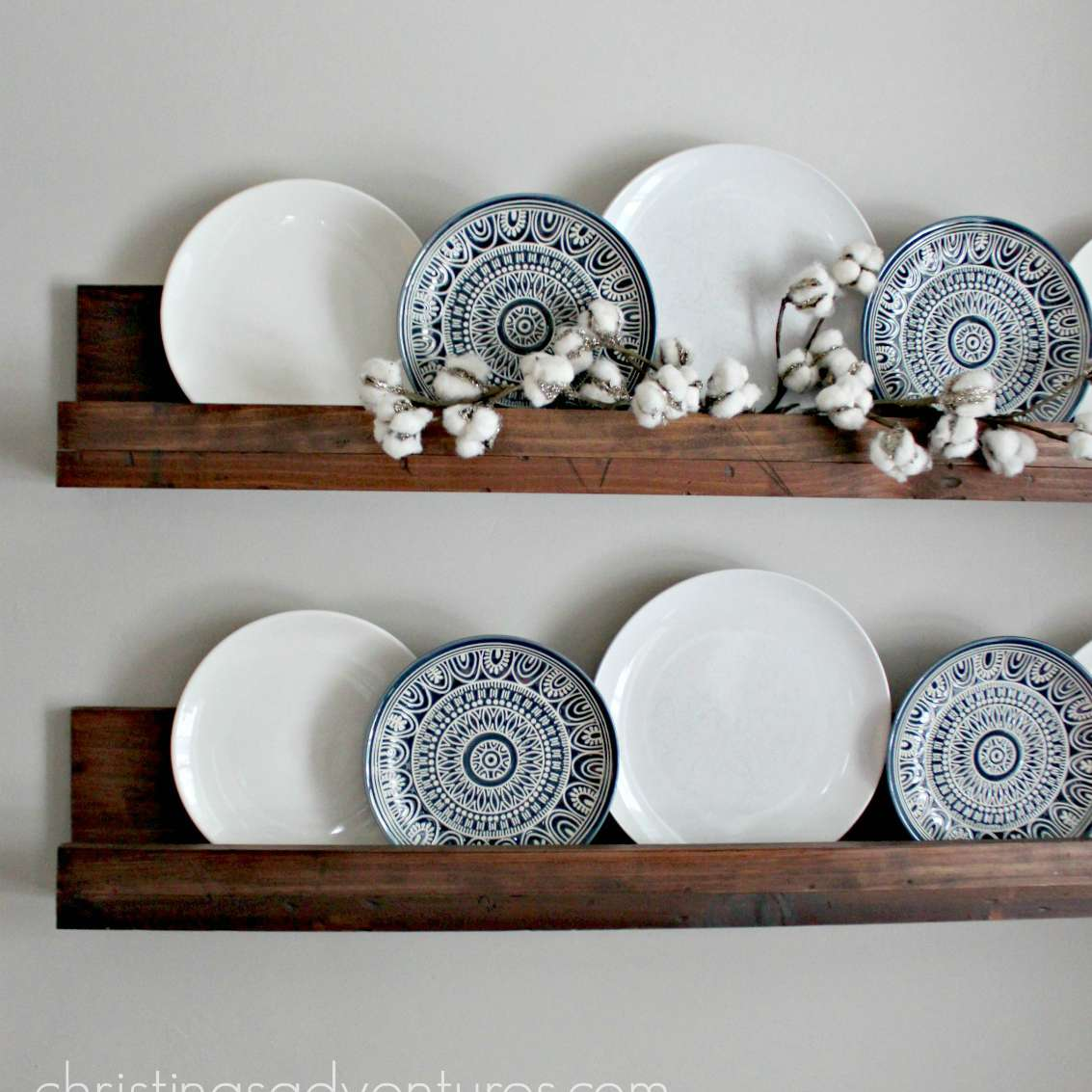 Wooden ledge display shelf with plates on top