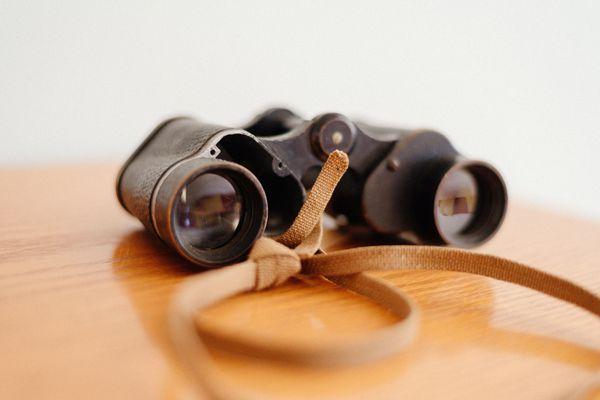 Binoculars on a table surface