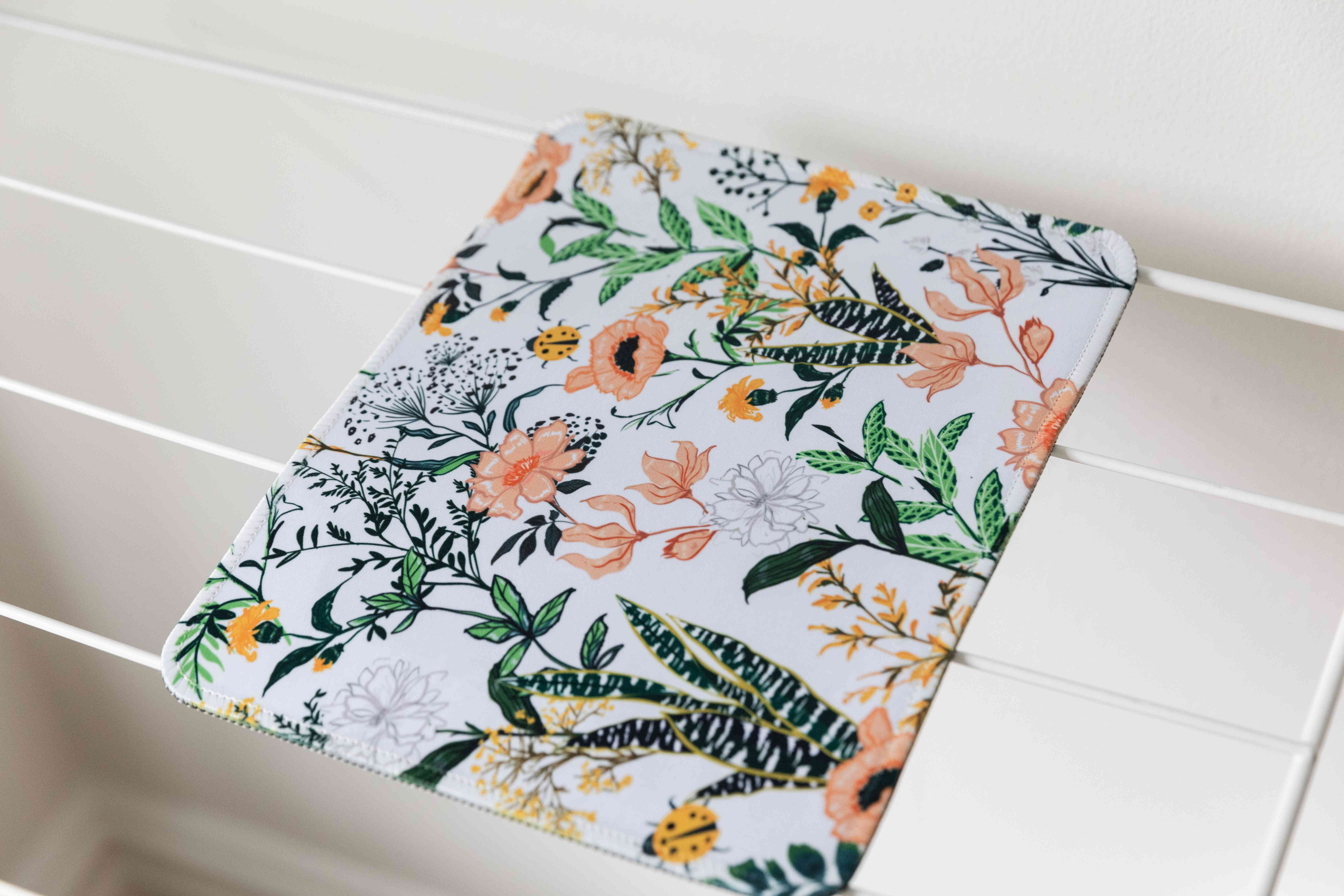 Floral mousepad air drying on dry rack