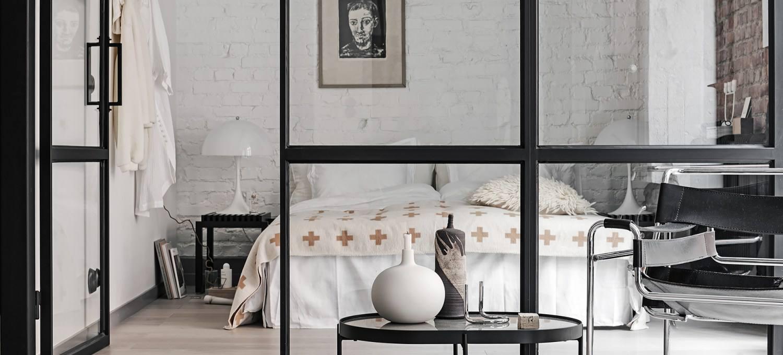 bedroom with white brick