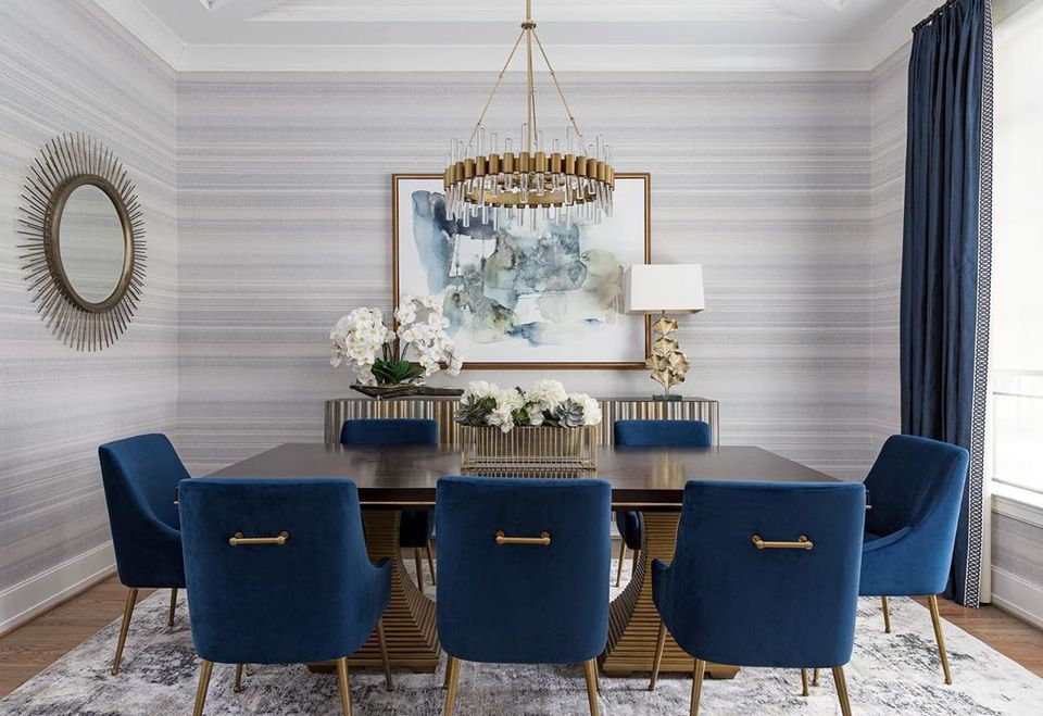 dining room with gray wallpaper and dark blue chairs