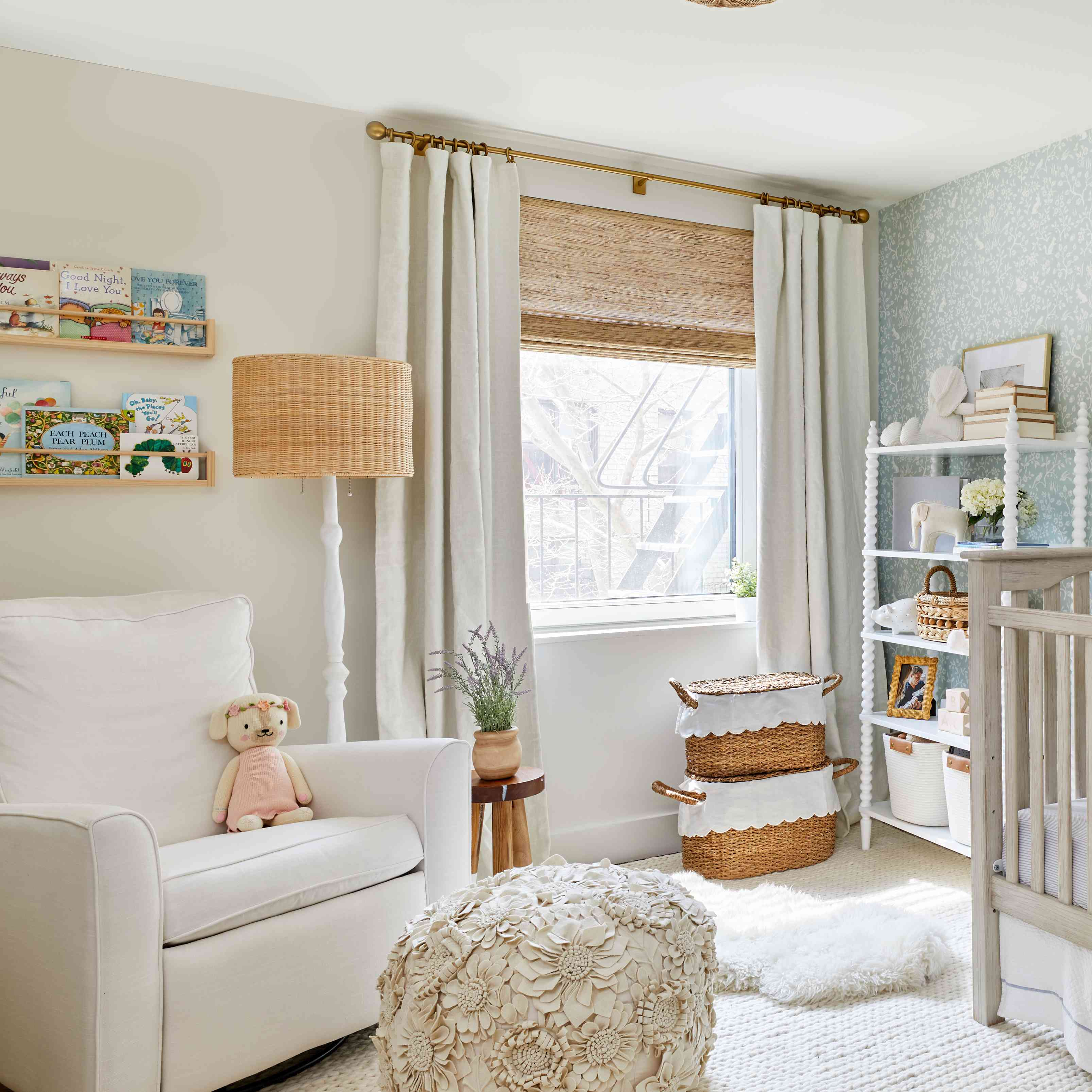 nursery with chair, cream white interior, with book ledges installed above chair