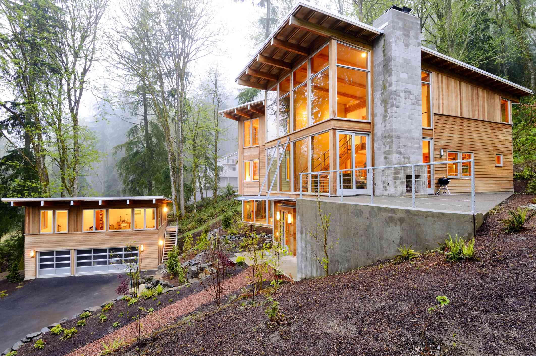 A house and a guest house, both with cedar siding.