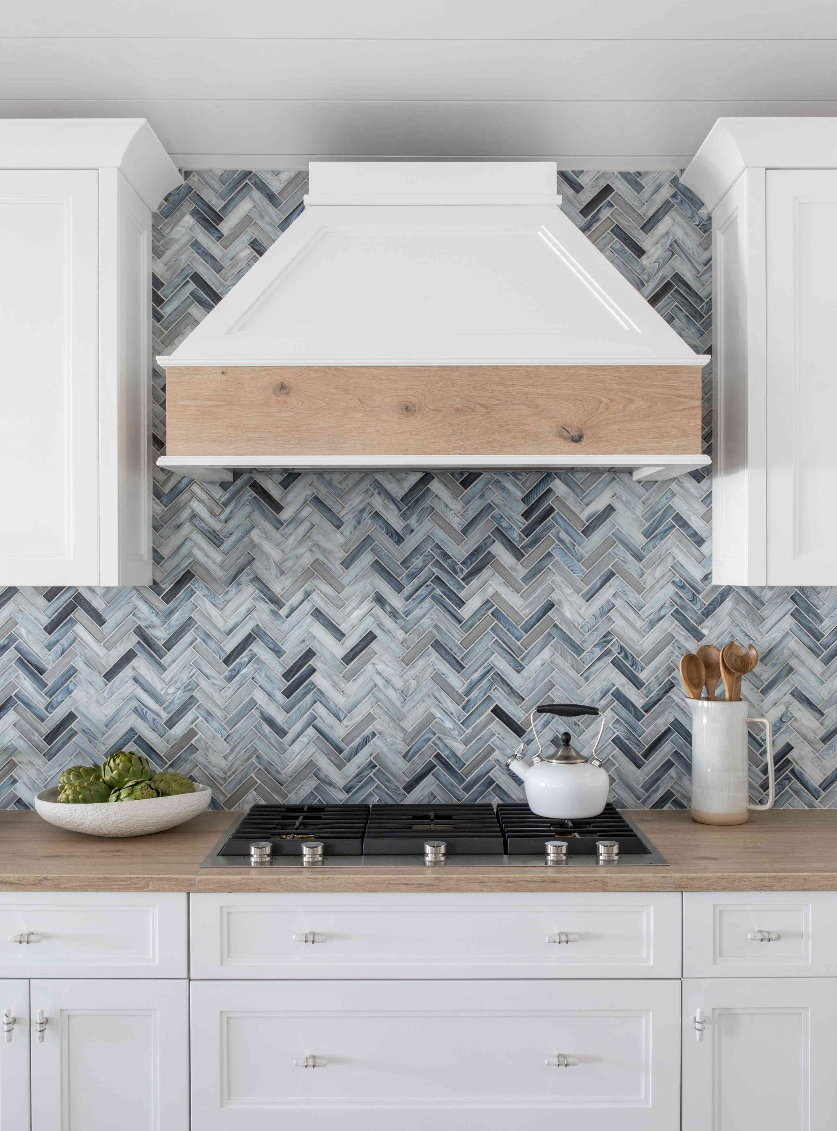 the range cover in the Long Beach Island kitchen of Karen B. Wolfe features white oak flooring