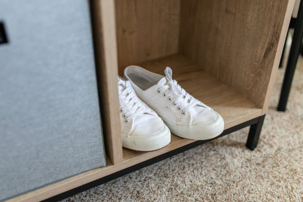canvas sneakers in a cabinet