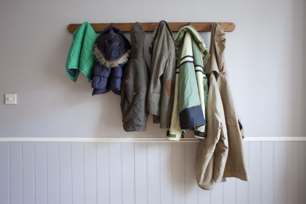 Coats hanging on coat rack