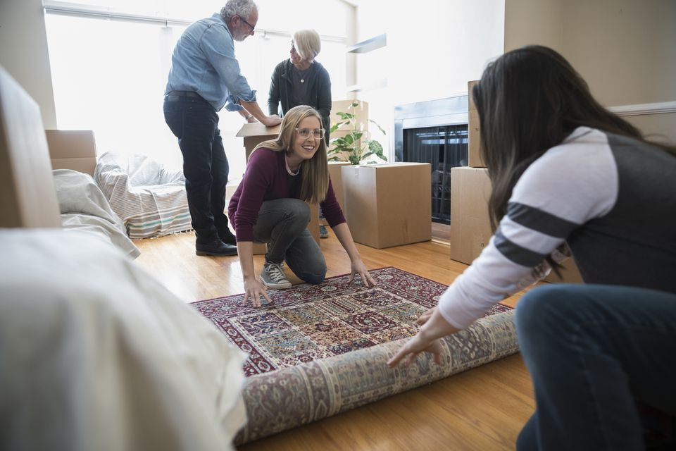 women rolling out rug