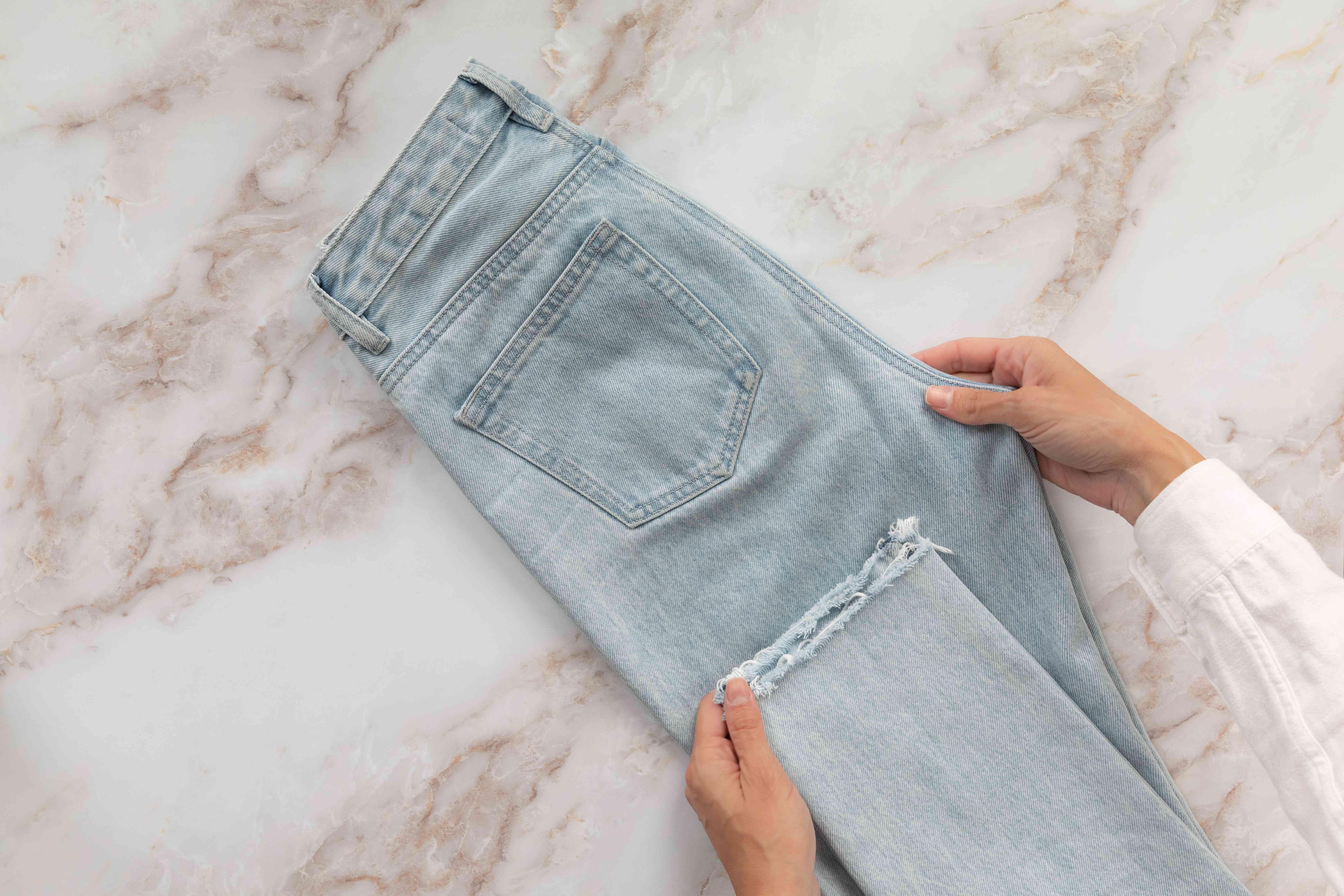 Jean leg cuff folded in half up toward leg