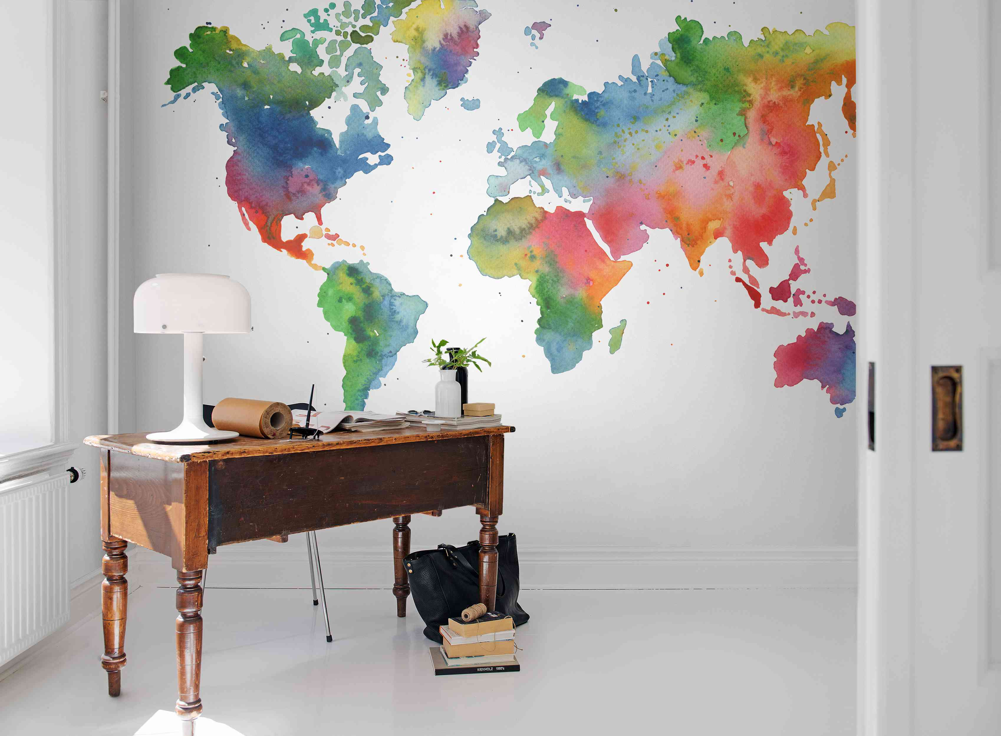 Rainbow colored world map wallpaper from Rebel Walls.