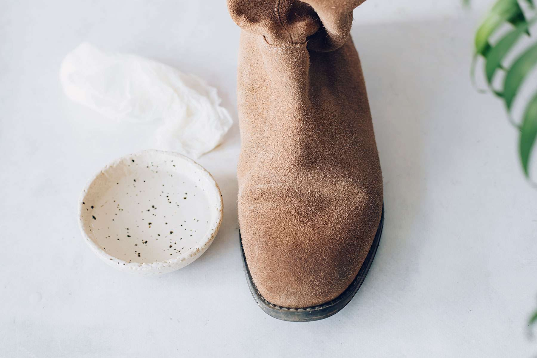 using a damp cloth on synthetic suede