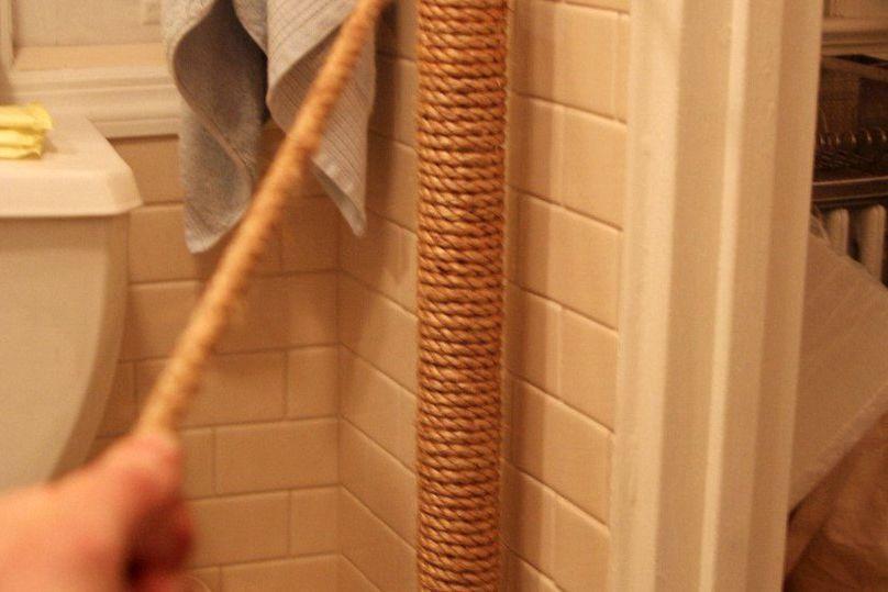 hide an ugly water pipe in bathroom