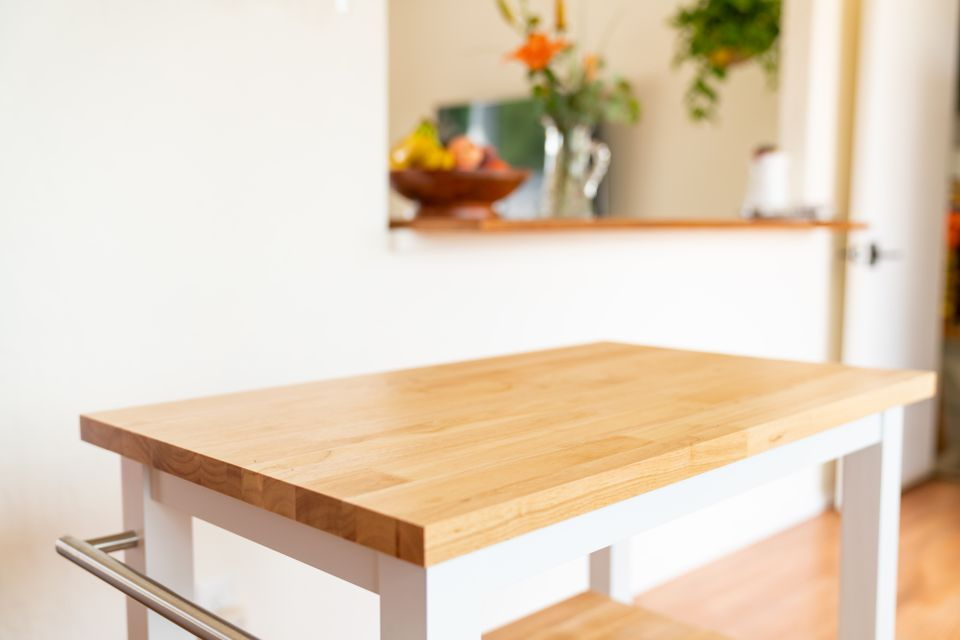 White and wood food prep table to be sanitized