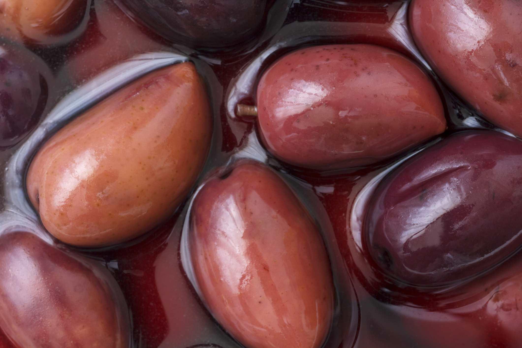 Brown Kalamata olives in liquid