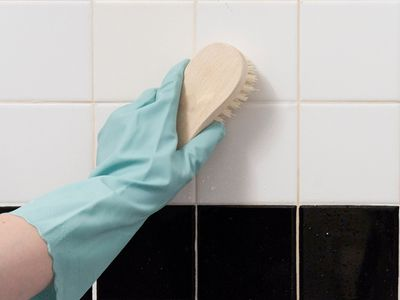 cleaning a shower wall