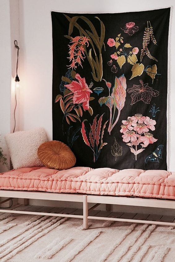 Pink bench and tapestry