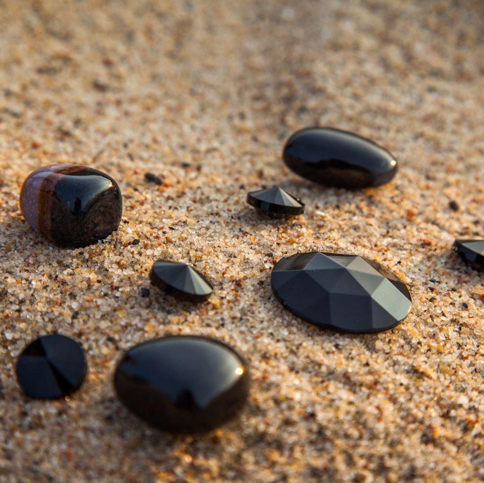 Black onyx stones on sand