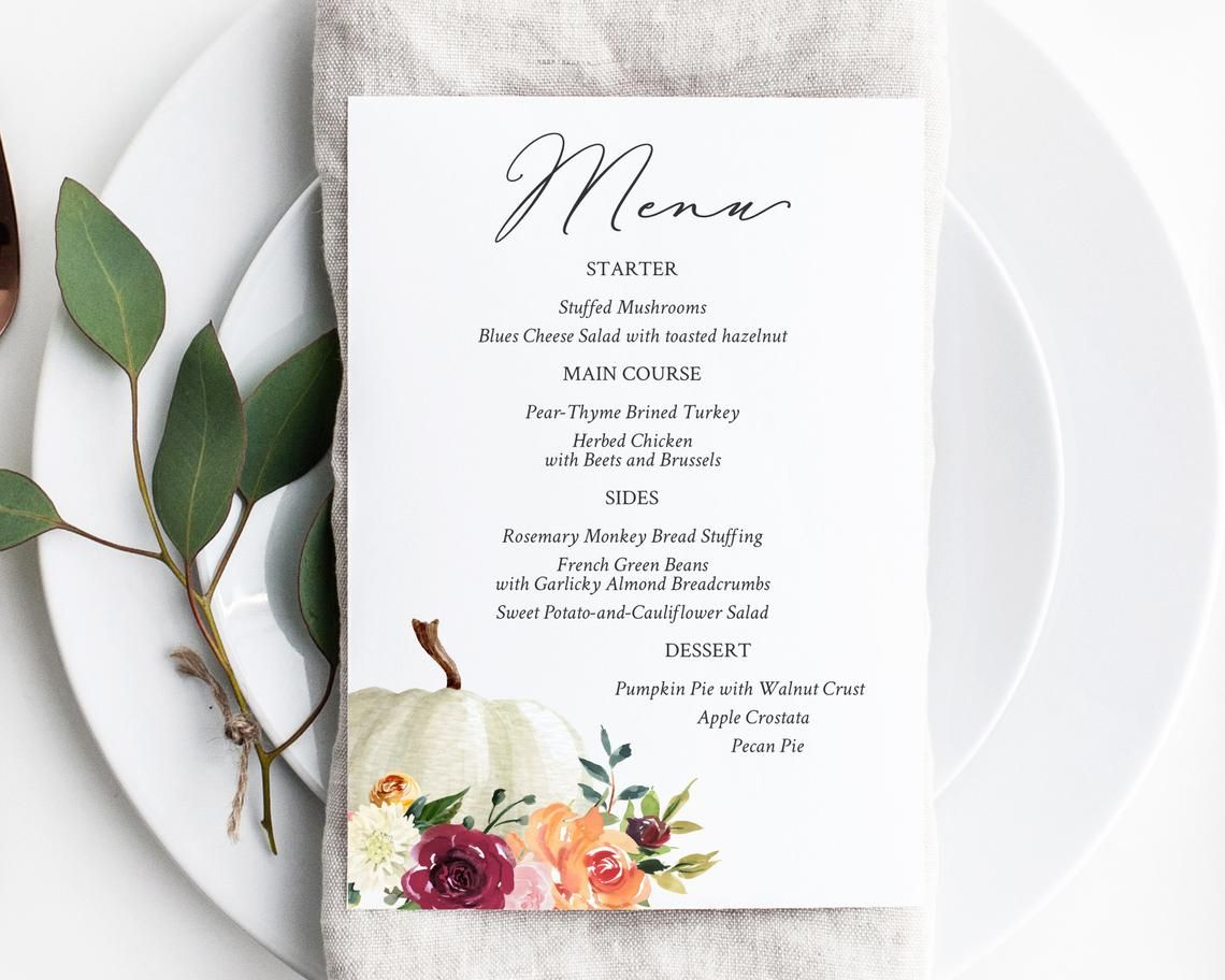 A Thanksgiving menu with a white pumpkin and flowers
