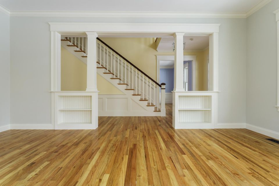 Unfurnished home interior with hardwood
