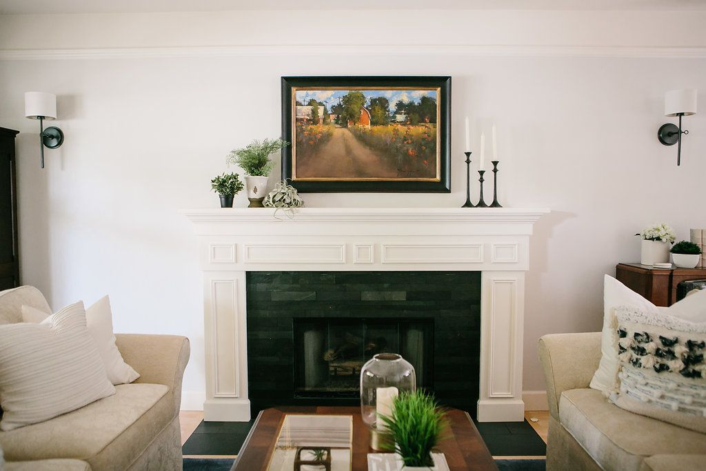 traditional mantel styling with painting and plants